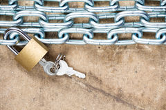 Padlock and chain on the dirty background Stock Photo