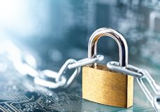 Padlock with chain on electronic printed circuit board. IT, internet protection, computer safety. Network Security, data security. Antivirus protection PC royalty free stock photos