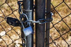 Padlock and Chain on Fence for Security, Safety and Protection Stock Image