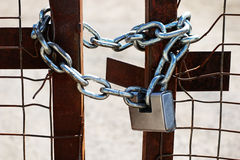 Padlock and chain on a gate Stock Images