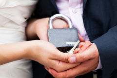 Padlock with the chain in the hands Royalty Free Stock Image