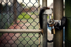Padlock on a Chain-link Gate Stock Photos