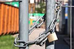 Padlock and chain at site fence Stock Images