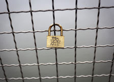 Padlock on Chainlink Fence. Royalty Free Stock Photos