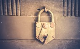 padlock in close positions over a old wood background stock photo