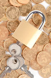 Padlock and coins Royalty Free Stock Photo