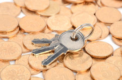Padlock and coins Stock Photo