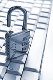 Padlock on computer keyboard Stock Images