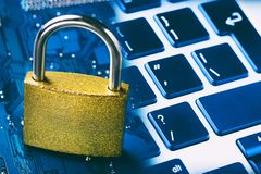 Padlock on computer motherboard and keyboard. Internet data privacy information security concept. Stock Photography