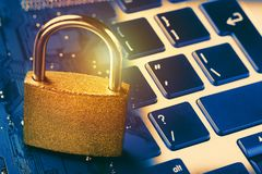Padlock on computer motherboard and keyboard. Internet data privacy information security concept. Toned. Royalty Free Stock Photography
