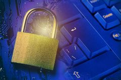 Padlock on computer motherboard and keyboard. Internet data privacy information security concept. Toned. Stock Images