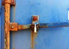 Padlock container door. Padlock on rusted container door Royalty Free Stock Images