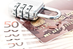 Padlock credit card and Euros. Combination padlock on credit card and wad of fifty Euro banknotes, isolated on white background Stock Photography
