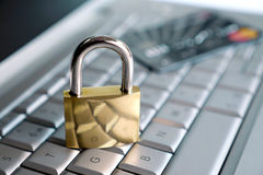 Padlock and credit card on keyboard Stock Photos