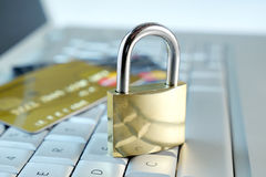 Padlock and credit cards on keyboard Royalty Free Stock Images