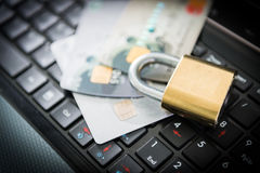 Padlock and credit cards on top of laptop Royalty Free Stock Photography