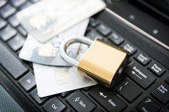 Padlock and credit cards on top of laptop Royalty Free Stock Photos