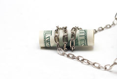 Padlock with Dollar banknote. Stack of Dollar banknote held together with padlock Stock Images