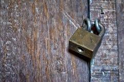 Padlock on Door. Gritty shot of a padlock on a wooden door Stock Image