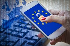 Padlock and EU flag on smartphone screen, GDPR metaphor. Padlock and EU flag on smartphone screen and female hands using it. Suitable for the EU General Data Stock Image