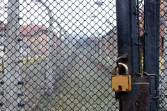 Padlock on a gate. A padlock on a wire gate Stock Photography