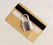 Padlock on gold credit, debit card. Internet, web safety, privacy and security concept. Stock Image