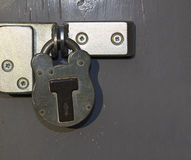 Padlock on grey door Stock Photo