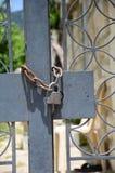 Padlock on grey gate Royalty Free Stock Image