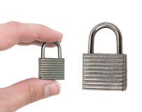 Padlock and hand Royalty Free Stock Images