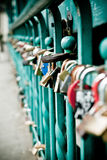 Padlock hanging on bridge Stock Photos