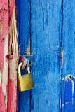 Padlock on highly textured door Stock Images