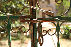 Padlock on an iron bars fence Stock Photos