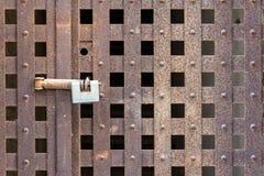 Padlock on an iron door Royalty Free Stock Photos