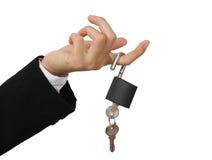 Padlock and key. S on finger isolated on white background Stock Image