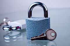 Padlock with a key. On a glass table Stock Photo
