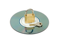Padlock key in CD disc Royalty Free Stock Images