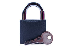 Padlock with a key  isolated. Padlock with a key on white background Royalty Free Stock Photography