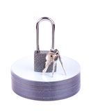 Padlock and key on the stack of CD Stock Images