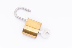 Padlock with key. On white background Stock Photos