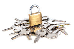 Padlock and keys. A padlock on a pile of keys Stock Photography