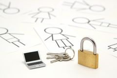 Padlock, keys, miniature laptop and many people on white background. Royalty Free Stock Photos
