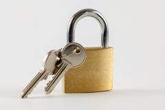 Padlock with keys on a white background Royalty Free Stock Photo