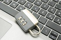 Padlock on laptop keyboard Stock Image