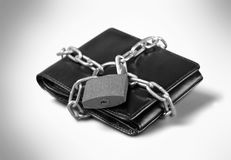 Padlock on leather wallet, money protection. Money wealth closeup financial protection leather accessory Royalty Free Stock Images
