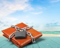 Padlock on leather wallet, money protection. Money wealth closeup financial protection leather accessory Stock Photography