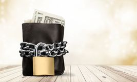 Padlock on leather wallet, money protection. Money wealth closeup financial protection leather accessory Stock Images