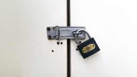 Padlock locked on a door. Padlock locked on a steel door Royalty Free Stock Photo
