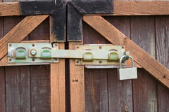 Padlock and a locking bar Stock Photography