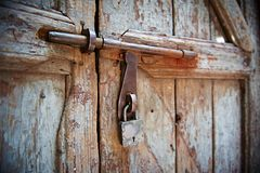 Padlock with locking bar on doors Stock Image