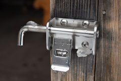 Padlock locking the wooden door Royalty Free Stock Image